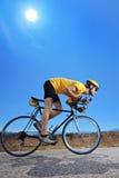 Biker  riding a bike on an open road Royalty Free Stock Photo
