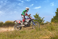 Biker riding enduro motorcycle Bmw GS 1200 RR Stock Image