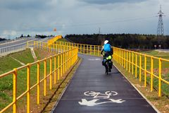 A biker riding on Green Velo bicycle route, the longest consistently marked cycle trail in Eastern Poland.  royalty free stock images