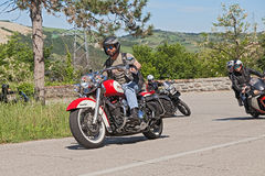 Biker riding Harley Davidson Royalty Free Stock Images