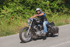 Biker riding Harley-Davidson Sportster Royalty Free Stock Images