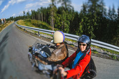 Biker riding his motorcycle on the road with the passenger Royalty Free Stock Photography