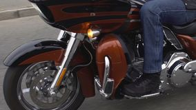 Biker riding motorcycle at long-distance race, adventurous lifestyle, freedom. Stock footage stock video footage