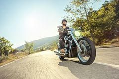 Biker riding a motorcycle Stock Image
