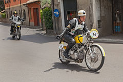 Biker riding an old italian bike Rumi SS TT Royalty Free Stock Photo
