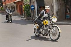 Biker riding an old italian bike Rumi SS TT. The driver Sascha Kripgans rides an old italian racing motorcycle Rumi SS TT during the historic rally Motogiro d' Royalty Free Stock Photo