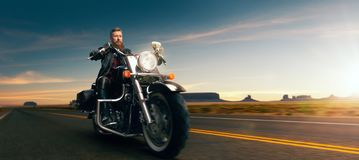Biker Riding On Classical Chopper, Sunset Royalty Free Stock Images