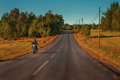 Biker riding on road Stock Photo