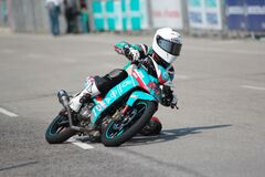 Biker Riding a Teal Sport Bike Royalty Free Stock Image