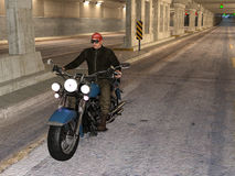 Biker riding in a tunnel Stock Images