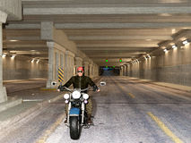 Biker riding in a tunnel. Young handsome biker riding motorcycle through the twilight tunnel. 3d render Royalty Free Stock Images