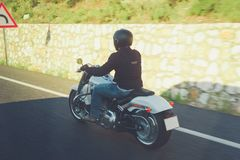 Biker riding unknown motorbike with blur movement, speed concept royalty free stock photo