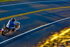 Biker on the road. Young rider on the road, Maui Royalty Free Stock Image