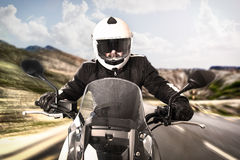 Biker on the road Stock Images