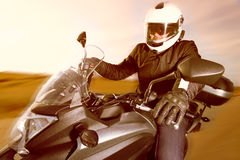Biker on the road Royalty Free Stock Photos