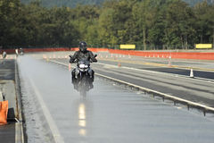 Biker on road Stock Images