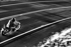 Biker on the road 2. Young rider on the road, Maui royalty free stock image