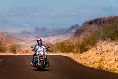 Biker on Route 66. Biker driving on the Highway on legendary Route 66 to Oatman, Arizona Royalty Free Stock Image