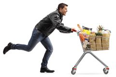 Biker running and pushing a shopping cart filled with groceries Royalty Free Stock Photography