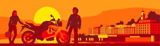 Biker's sunset break. Sunset: two bikers take a break from a long trip Stock Image