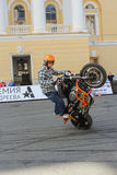 Biker showing a motorcycle driving skills. Royalty Free Stock Images