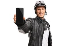 Biker showing a phone and smiling Stock Image