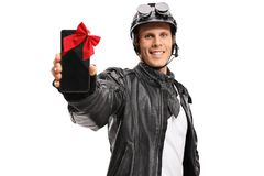 Biker showing a phone wrapped with a ribbon as a present Stock Images
