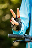 Biker showing victory sign Royalty Free Stock Images