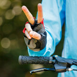 Biker showing victory sign Stock Photo