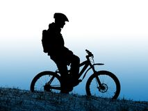 Biker silhouette. Mountain biker silhouette with clean blue sky Royalty Free Stock Image