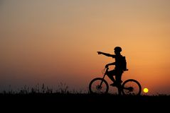 Biker silhouette. Mountain biker silhouette in sunrise Royalty Free Stock Photography