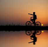 Biker silhouette. Mountain biker silhouette in sunrise Stock Photos