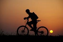 Biker silhouette. Mountain biker silhouette in sunrise stock photo