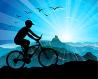 Biker Silhouette  with mountains Stock Images