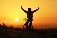 Biker silhouette and sunrise. Bicycle sport-Sunrise-Peace and relax day royalty free stock images