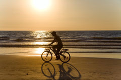 Biker silhouette at sunset Stock Image