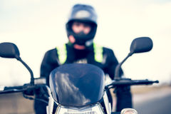 Biker sitting on his motorcycle Royalty Free Stock Images