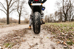 Biker sitting on motorcycle on an empty road, close-up view on r Royalty Free Stock Image