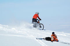 Biker and skier. Biker and fall skier Royalty Free Stock Photos