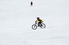 Biker and skier. In mountain Stock Photo