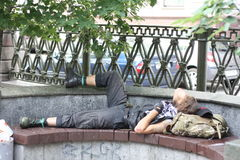 Biker sleeping on a bench Royalty Free Stock Photography