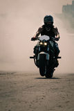 Biker speeding on a road Stock Images