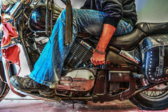 Biker starting a motorcycle Stock Photo