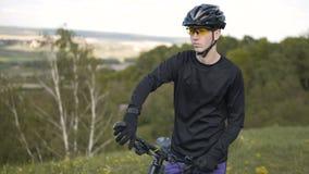 Biker starts to ride stock video footage