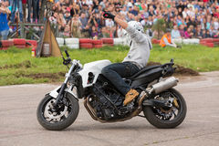 Biker stunt shows on motorcycle Royalty Free Stock Photography