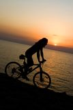 Biker on sunset. Royalty Free Stock Photos
