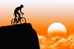 Biker with sunshine. On rock Stock Photo