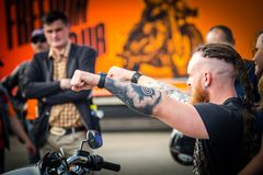 Biker tattooed Crazy Hohols Kiev Ukraine april2018. Biker tattooed hands on Crazy Hohols Bikers club open season Kiev Ukraine 21 april 2018 Royalty Free Stock Images