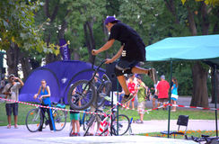 Biker tricks in urban park Royalty Free Stock Image