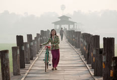 Biker on U Bien U Pain Bridge, Amarapura, Myanmar Stock Photography